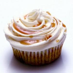 Cupcakes de curry de zanahoria vegana de Bruselas con glaseado de queso crema y descuento de curry de arc